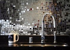 Mirror Mosaic Tile. Backsplash. It's like a disco ball for every day. I love it! And you gotta admit its a step up from the 70s wall mirrors.
