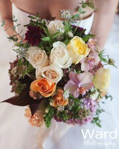Harmony Harvest Farm - Virginia Florists - Bright and multi-colored rose and orchid wedding bouquet with orange, purple, yellow and green