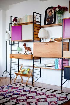 Mid century wall mounted bookcase--colorful & modern home decor via @cpavone