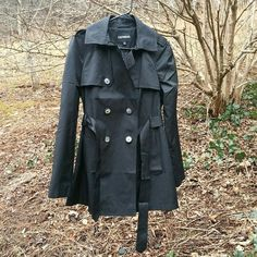 Express Trench Coat Brand new with tags! Sold out! Material: Cotton/Polyester. *Slick* Was bought for me for Christmas, but I will never wear it. Size medium. Taking reasonable offers through the offer button, only! Pictures are taken outside for better lighting and detail! Express Jackets & Coats Trench Coats