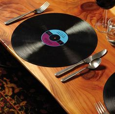 Vinyl Record Dinner Placemats Vinyl records might be an obsolete technology but they function perfectly as dinner placemats. Easy to clean and dishwasher safe, these vinyl record dinner placemats are.