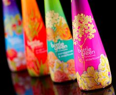 """Designed by Rachel Pitman   """"Premium soft drink brand Bottlegreen is to unveil a range of stylish limited edition sparkling pressé bottles for the festive season, in stores from early November.  The designs were created by textile design graduate, Rachel Pitman, following a nationwide talent search by Bottlegreen Drinks Co."""""""