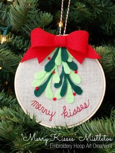 an embroidery hoop and felt christmas ornament with a mistletoe theme complete tutorial with photos