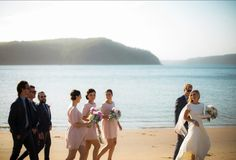 Lovely photo idea if near the beach during your wedding. Like the idea of little bridesmaids dresses, just not these ones.