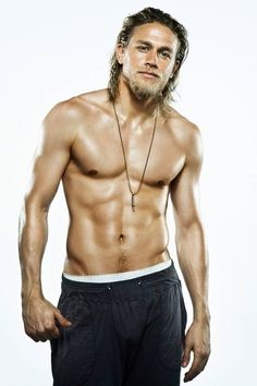 Charlie Hunnam - his face and body are out of this world. I think few who've watched his show Sons of Anarchy would disagree.