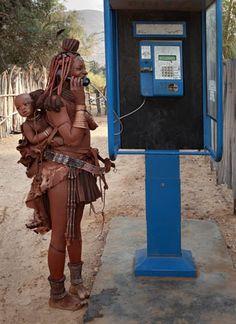 Mrs. Mukamuhuvare, Northern Namibia by Obie Oberholzer. Civilisation clash...