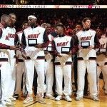Oct 30, 2012; Miami, FL, USA; Miami Heat shooting guard Dwyane Wade (far left) – power forward Chris Bosh (second from left) – small forward LeBron James (third from left) and teammates celebrate after receiving their NBA championship rings before a game against the Boston Celtics at American Airlines Arena. The Heat won 120-107. Mandatory Credit: Steve Mitchell-US PRESSWIRE