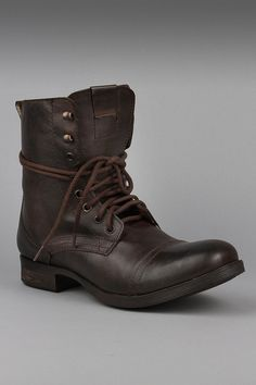Steve Madden Gramm Men's Boot in Brown.    Rock an edgy style with these dark brown boots by Steve Madden.  These boots lace up the front and end mid-calf. Distressed leather boot features a 1 inch heel with rubber traction outersole.