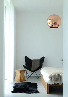 bare white space with a butterfly chair, plenty of cowhide, sheepskin, and fur, and a single copper pendant from tom dixon Home Bedroom, Bedroom Decor, Bedrooms, Bedroom Designs, Master Bedroom, Bedroom Corner, Copper Lighting, Tom Dixon, My New Room