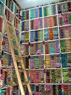 Amazing colourful image of silk threads in a store -- want 2 do this with books...........