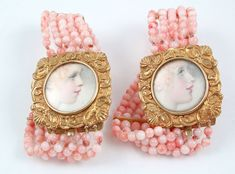A pair of portrait miniature bracelets  Georgian Circa 1820 -   Two delightful portraits (sisters? mother and daughter?) hand-painted on ivory and set in 18K gold mounts.  Angel-skin coral beads are a recent addition.