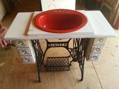 Repurposed singer sewing machine into a vanity.
