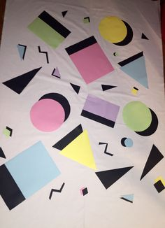 90's theme party backdrop! Go into your nearest fabric store {I went to Jo-Ann's} and find the biggest white cotton fabric available. Of course you can choose whichever color or even a patterned one. I was going for simple and shape filled. I found packs of card stock in pastel colors and black and cut them out. Just used double sided adhesive stickers fit for fabric. Used the black card stock more for the 3D look.