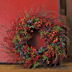 Door wreath made from berries. Very natural, rustic and homely looking. The…