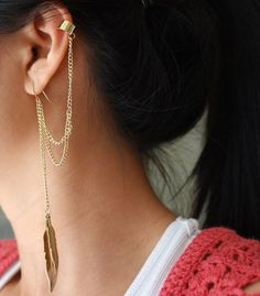 feather cuff earring. Claire's may have this, but they for sure have 100's more to choose from online, go take a check!