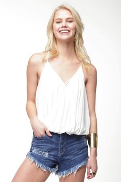 90s Lullaby - Crossover White Drape Cami, $9.99 (http://www.90slullaby.com/shop/crossover-white-drape-cami/)