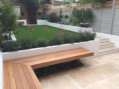 Modern garden design London travertine paving artificial grass raised beds - All About