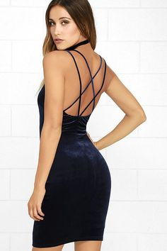 The Wow-Worthy Navy Blue Velvet Bodycon Dress will earn you plenty of admiring glances! Soft and stretchy velvet forms a triangle bodice, supported by twin spaghetti straps that crisscross at back. Sexy bodycon fit travels to a mini-length skirt.