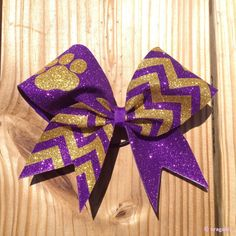 Purple and gold chevron print bow with paw. Lila Gold, Purple Gold, Cheerleading Accessories, Fancy Bows, Cheer Bows, Cheerleader Bows, Cheer Hair, Gold Chevron, Middle Schoolers