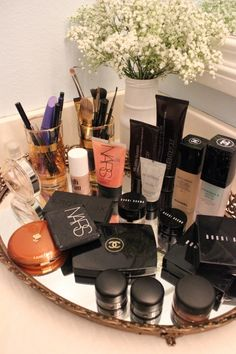 A pretty mirrored tray is a great way to organize and display your daily beauty products that you want to keep handy. Too bad for me I'd need a counter the size of a kitchen block! haha | #makeup #beauty #organization