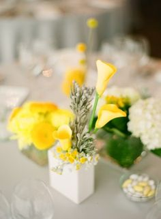 Yellow calla lilies in square white vase | photography by http://www.lauraivanova.com/