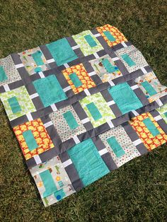 Cute baby quilt with Tim and Beck fabric