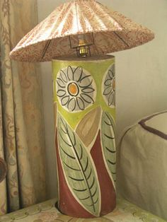 Lamp base, circa 1930-35, painted wood, light fitting (see lampshade T/172), decorated by Duncan Grant, 51 cm x 20 cm.