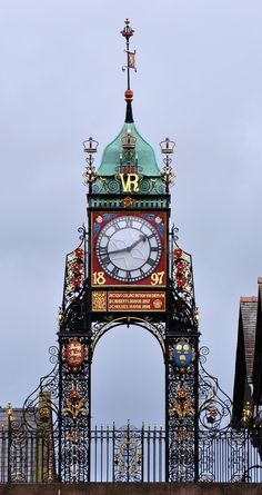 "Queen Victoria Clock in Chester, England - photo by Mike, via Flickr; ""The clock tower marks the site of the orginal entrance to the Roman fortress and town, ca. AD 74 or 75. Rebuilt through the centuries, the present gateway dates to AD 1768 and the clock was added in 1899 to commemorate the Queen Victoria's diamond jubilee in 1897."""
