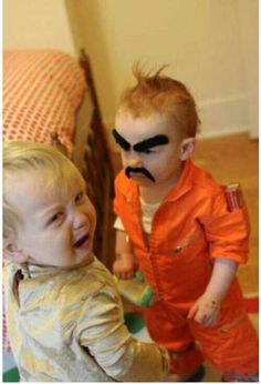 Too funny, baby with bushy eyebrows and mustache