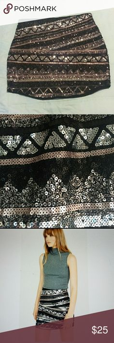 Express Sequin Mini Skirt Curved Hem This is a GORGEOUS skirt with silver, gold and black sequins. Size Medium. Stretchy waist, sequins front and back. I purchased this from another Posher recently and it's just too long on my shorter legs. Express Skirts Mini