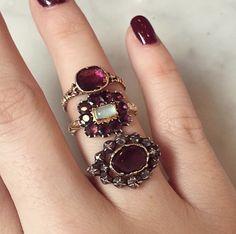 Antique garnet rings on hand