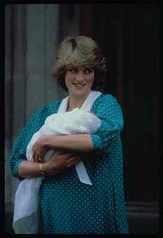 June 22, 1982: Prince Charles and Princess Diana hold their newborn son Prince William as they leave St. Mary's Hospital in Paddington, London.