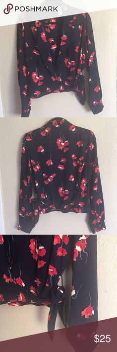 """Liz Claiborne Navy Floral Print Wrap Blouse Preloved top in excellent condition. Navy blue with a red & yellow floral print wraparound style blouse, ties on the side. No buttons on top, except on sleeves. 100% polyester. Length is 20"""" and approximately 18"""" across the chest. ❌NO TRADES OR PAYPAL❌ Liz Claiborne Tops Blouses"""