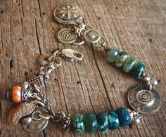 Authentic Vintage Kuchiyan Adornments and Crackled Agate Beaded Charm Bracelet. $52.00, via Etsy.