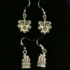 "Green Man Earrings $5 Castle Earrings $5  To place an order, visit our Facebook page ""Moonsong Jewellery"" or email moonsongjewellery@gmail.com"