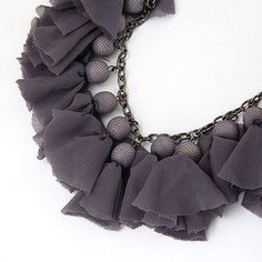 Chiffon squares wrapped around large acrylic beads...adorable!