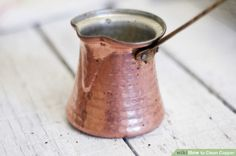 Nice Copper Pitcher with a long Metal Handle.  Article discusses how to keep copper clean.