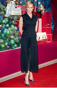 Uma Thurman in a black Dolce & Gabbana midi dress and vest