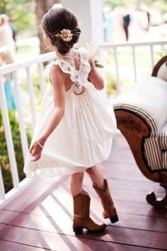 Flower girl - cowgirl boots, crossed back, but with a tutu!