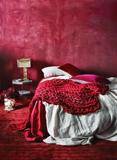 Red makes for a rich, romantic colour scheme that is not for the faint hearted.