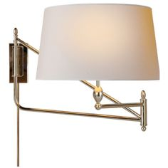 This 1 light Swing-Arm Wall Light from the Thomas OBrien Paulo collection by Visual Comfort Lighting will enhance your home with a perfect mix of form and function. The features include a Bronze with
