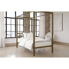 This collection meets medieval influences with this striking canopy bed the perfect addition to any bedroom, no matter your style. The straight, simple lines add a contemporary touch, with a built-in bed headboard and an all-gold metal finish for a truly timeless look. When it comes to comfort, this canopy bed has it all: a sturdy metal bed frame, as well as side rails for guaranteed stability and durability. The metal slat base is designed to allow air to pass freely beneath your bed, which…
