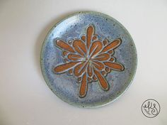 Size: 4.75 wide x .75 Tall This blue plate is hand carved with my floral design which makes for a beautiful decorative piece as well as great