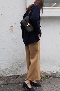 celine shoulder bag, navy sweater, tan trousers, suede navy pumps