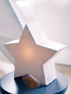 Create a starry night scene to help your little ones drift off with our three dimensional table top porcelain star night light. Each light emits a soft glow through the porcelain and includes little perforate edges that let the light dance through. Click here to view our useful lighting buying guide, andtake a look at our blogfor ideas on how incorporate lighting into your home.