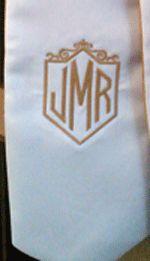 Shield monogram in gold