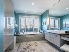 Turquoise Bathroom with huge soaking tub and awesome sink....