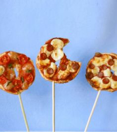 Mini pizza on sticks. Cute party idea.