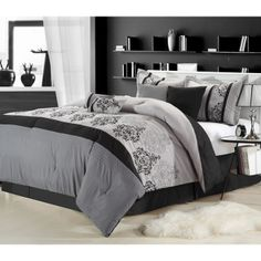 This black, white and gray eight-piece comforter set features embroidered classic damask pattern accents, and all the pieces in the set are coordinated, so you don't have to search for complementary items. This complete set is machine washable.