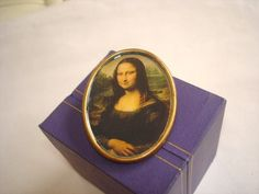 Lady Jewelry Mona Lisa Brooch. $14.99, via Etsy.